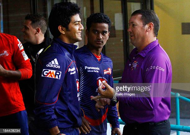 Fourth umpire Johan Cloete chats to Unmukt Chand of the Delhi Daredevils during the CLT20 match between Auckland Aces and Delhi Daredevils from...