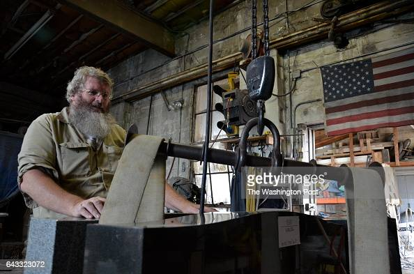 Fourthgeneration stonecarver John Kinnaird in the Thurmont memorial shop founded by his father in 1963 is also a town commissioner and historian in...