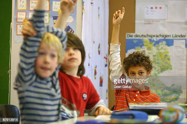Fourthgrade children attend class in the elementary school at the John F Kennedy Schule duallanguage public school on September 18 2008 in Berlin...
