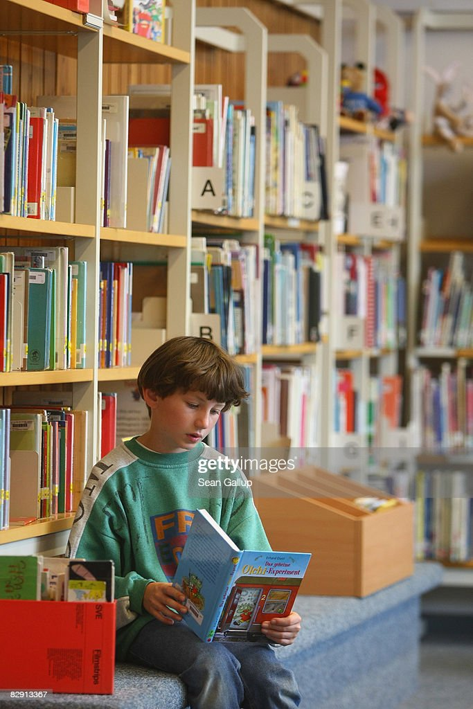A fourth-grade student looks at books in the elementary school at the John F. Kennedy Schule dual-language public school on September 18, 2008 in Berlin, Germany. The German government will host a summit on education in Germany scheduled for mid-October in Dresden. Germany has consistantly fallen behind in recent years in comparison to other European countries in the Pisa education surveys, and Education Minister Annette Schavan is pushing for an 8 percent increase in the national educaiton budget for 2009.