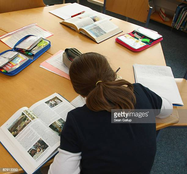 A fourthgrade student works on homework in the elementary school at the John F Kennedy Schule duallanguage public school on September 18 2008 in...