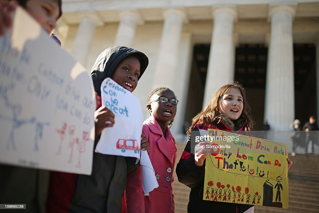 Fourth-graders from Watkins Elementary School display hand-written signs during a celebration of Martin Luther King Jr.'s birthday on the steps of the Lincoln Memorial on the National Mall January 18, 2013 in Washington, DC. Fifth-graders from the school took turns reciting from memory parts of the 'I Have a Dream' speech from the very spot where King originally delivered the oration in August of 1963.
