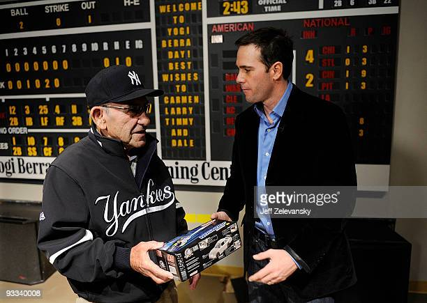 Fourtime Nascar champion Jimmie Johnson presents a model of his Lowe's Chevrolet to Baseball Hall of Famer Yogi Berra at a tour of the Yogi Berra...
