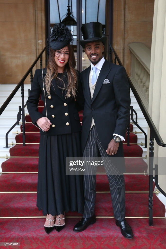 Four-time Olympic champion Sir Mo Farah and his wife Tania pose, prior to him receiving his knighthood from Queen Elizabeth II at Buckingham Palace on November 14, 2017 in London, United Kingdom.