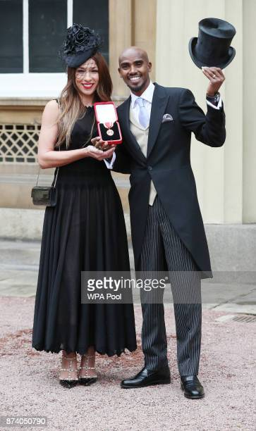 Fourtime Olympic champion Sir Mo Farah and his wife Tania pose prior to him receiving his knighthood from Queen Elizabeth II at Buckingham Palace on...