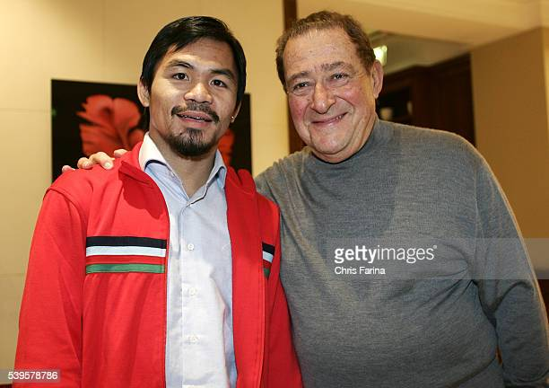 Fourtime world champion Manny 'Pacman' Pacquiao General SantosPhilippines is greeted by Hall of Fame Top Rank promoter Bob Arum at the Grosvenor...
