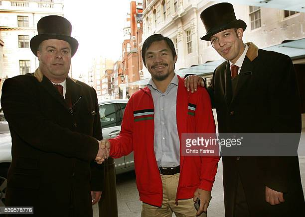 Fourtime world champion Manny 'Pacman' PacquiaoGeneral SantosPhilippines is greeted by bellman at the Grosvenor House hotel as he arrives in downtown...