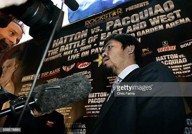 Fourtime world champion Manny 'Pacman' PacquiaoGeneral SantosPhilippines talks with reporters during a press rally at the Trafford Center in...