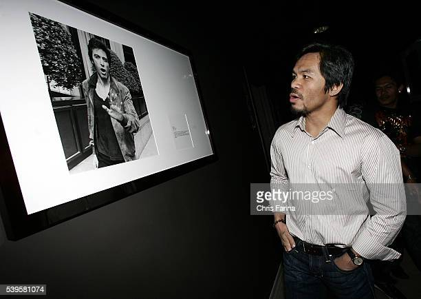 Fourtime world champion poundforpound king Manny 'Pacman' Pacquiao admires a photograph of Al Pacino in the famous Roosevelt Hotel before attending...