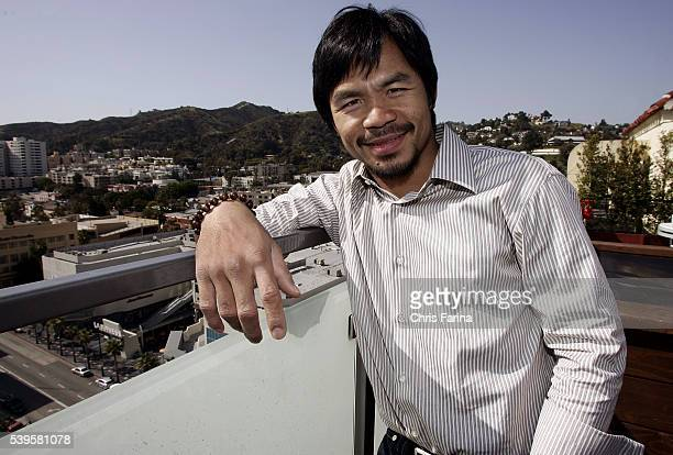 Fourtime world champion poundforpound king Manny 'Pacman' Pacquiao checks out the view of the Hollywood Hills from high atop the famous Roosevelt...