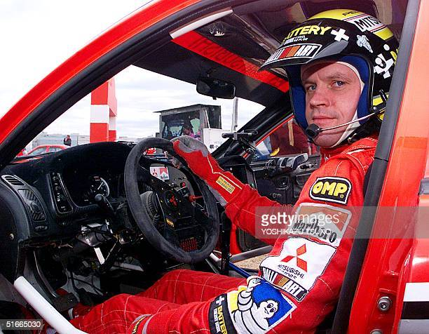 Fourtime WRC overall champion Tommi Makinen of Finland shows his driving skill before Japanese fans during a demonstration run with the Mitsubichi...