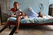 Fouryearold Erianni Diaz has twice fallen through a hole in the floor of the condemned hotel where she and her grandmother live in the poor city of...