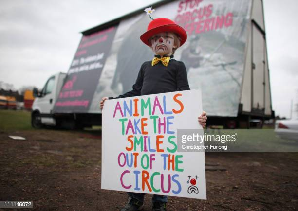 Fouryearold Gabriel Ryan takes part in a protest outside Bobby Roberts Circus on Knutsford Common on March 30 2011 in Knutsford England Bobby Roberts...