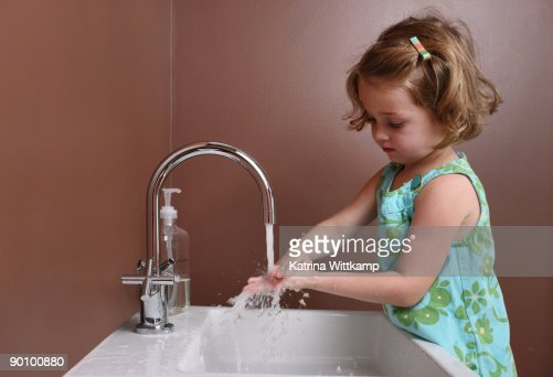 Four-year-old girl washing hands.  : Stock Photo