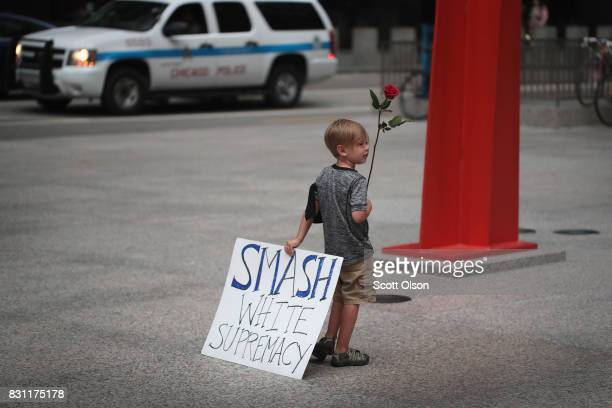 Fouryearold Leo Griffin leaves a protest against the altright movement held to mourn the victims of yesterdays rally in Charlottesville Virginia on...