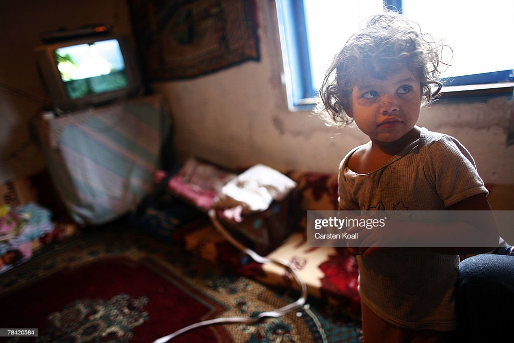 Four-year-old Roma refugee Zejnsa stands is shown in her family house in the Cesmin Lug refugee camp in the Serbian district December 12, 2007 in Kosovo province, Serbia. One hundred and fourty-four refugees live in the camp near toxic metal waste left by the Trepca mines, living in extremely poor conditions with no running water. Members of the Roma minority were forced to flee their homes in the Mahala district in southern Mitrovica during the Kosovo war in the 1999. They settled in the Serb-populated northern side of the divided province. Were independence to come to Kosovo, the north would continue as a Serbian enclave. Kosovo, administered by the United Nations since the 1990 conflict, is home to approximately 120,000 Serbs, who face an uncertain future should the province, with its majority Albanian population, become independent under a U.N. proposed plan.