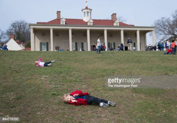 Fouryearold Sam Merrill and his twoyearold sister Martha Merrill do log rolls down the hill at Mt Vernon VA on February 22 2016 It was a beautiful...