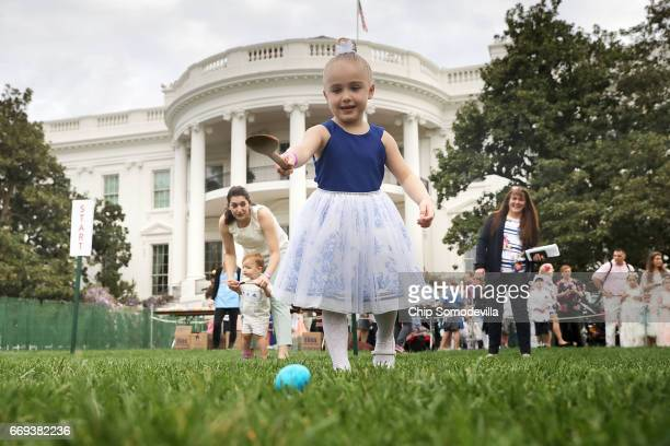 Fouryearold Vittoria Colonna of Marcus Hook PA rolls an colored egg down the White House South Lawn during the 139th Easter Egg Roll April 17 2017 in...