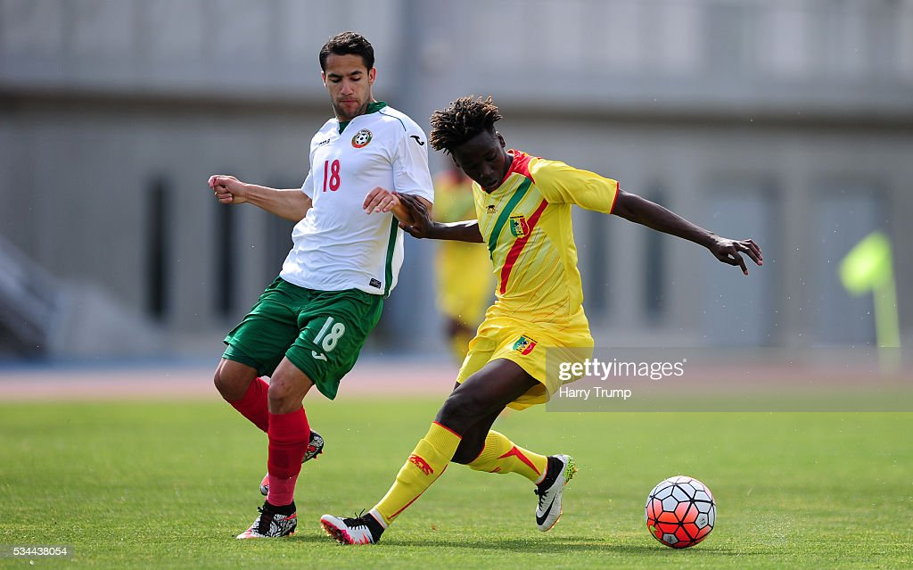 Fousseni Diabate of Mali is tackled by Borislav Tsonev of Bulgaria during the Toulon Tournament match between Mali and Bulgaria at the Stade Leo Lagrange on May 26, 2016 in Toulon, France.