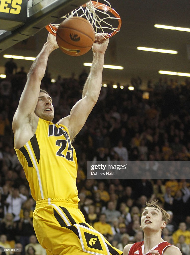 Foward Eric May #25 of the Iowa Hawkeyes dunks the ball during the second half over forward Sam Dekker #15 of the Wisconsin Badgers on January 19, 2013 at Carver-Hawkeye Arena in Iowa City, Iowa. Iowa won 70-66.