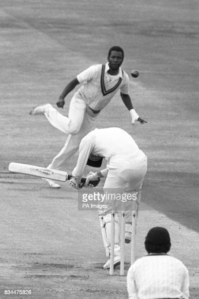 Fowler ducks a bouncer from West Indian bowler Malcolm Marshall