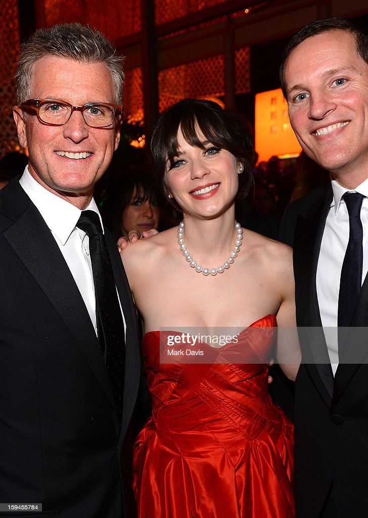 Fox Chairman of Entertainment Kevin Reilly, actress Zooey Deschanel, and COO Fox Broadcasting Joe Earley attends the FOX After Party for the 70th Annual Golden Globe Awards held at The FOX Pavillion at The Beverly Hilton Hotel on January 13, 2013 in Beverly Hills, California.