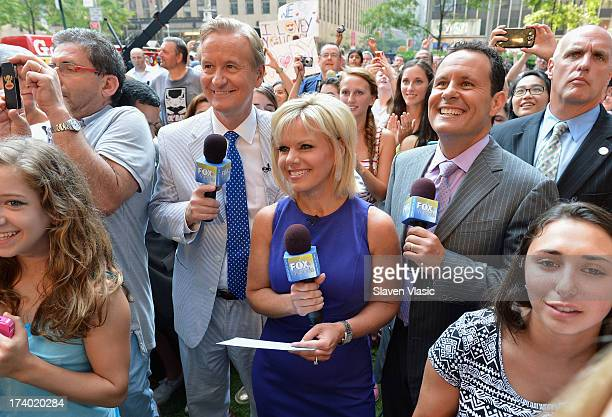 Fox Friends hosts Steve Doocy Gretchen Carlson and Brian Kilmeade during 'FOX Friends' All American Concert Series outside of FOX Studios on July 19...