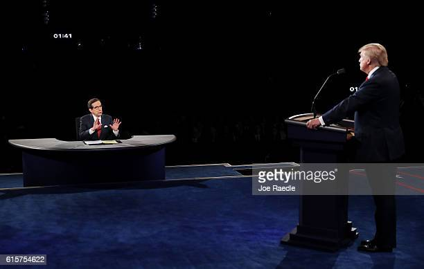 Fox News anchor and moderator Chris Wallace asks Republican presidential nominee Donald Trump a question during the third US presidential debate at...