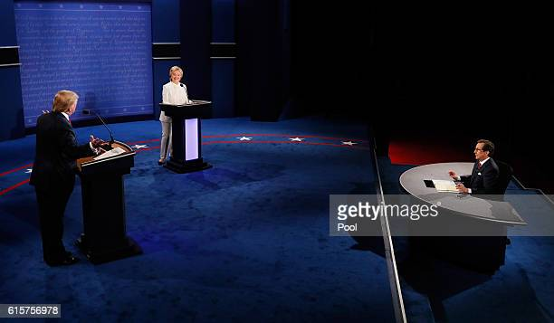 Fox News anchor and moderator Chris Wallace speaks to Republican presidential nominee Donald Trump and Democratic presidential nominee former...