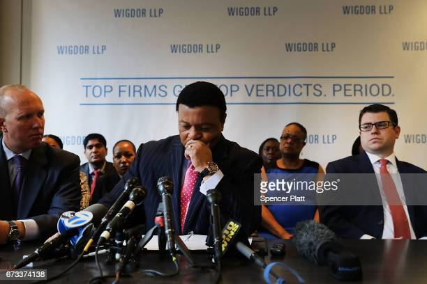 Fox News anchor Kelly Wright becomes emotional as he joins other current and former Fox employees at a press conference this morning organized by his...