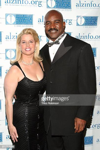 Fox News anchor Rita Cosby and Boxer Evander Holyfield attend the Fisher Center Gala at JeanGeorges V Steakhouse November 22 2004 in New York City