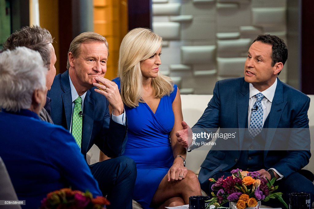 Fox News Hosts Steve Doocy, Ainsley Earhardt and Brian Kilmeade during actor Eric Stonestreet and Mother Jamey Stonestreet Visit 'Fox & Friends' at FOX Studios on May 5, 2016 in New York City.