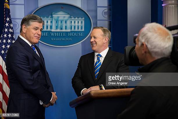 Fox News television personality and political commentator Sean Hannity speaks with White House Press Secretary Sean Spicer in the James Brady Press...