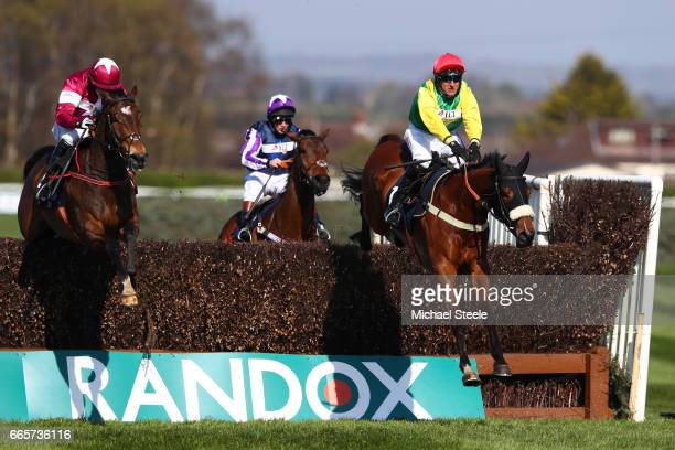Fox Norton ridden by Robbie Power clears the second to last ahead of Sub Lieutenant ridden by Brian Cooper on the way to victory during the JLT...