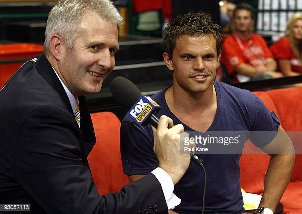 Fox presenter Andrew Gaze talks with Byron Schammer of the Fremantle Dockers Football Club during the round eight NBL match between the Perth...