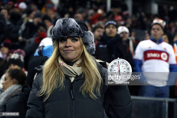 Fox sideline reporter Julie StewartBinks holds up a temperature gauge showing that the game was starting with the temperature at the freezing point...