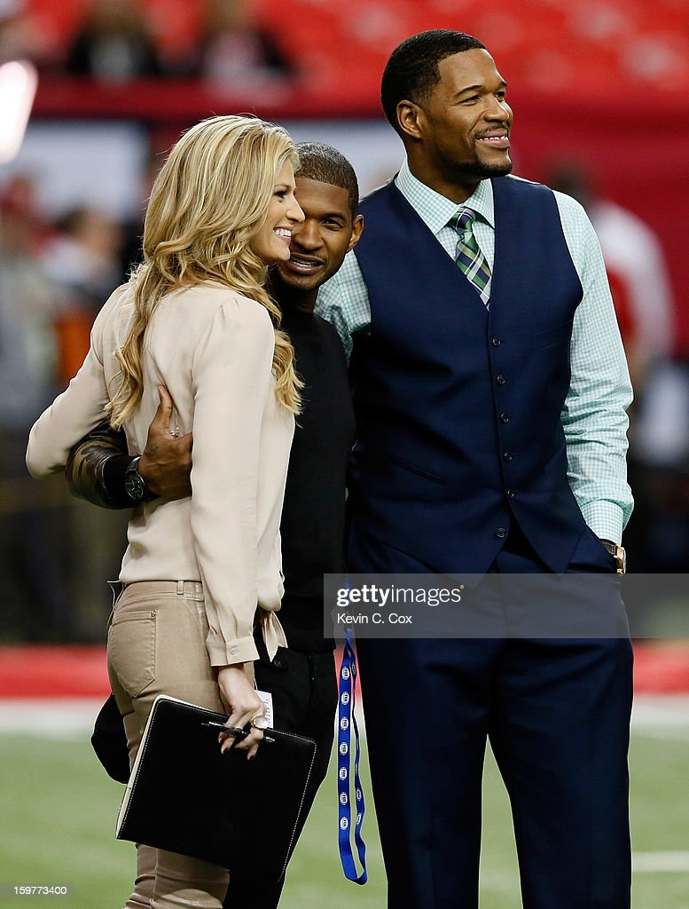 Fox Sports reporter and host Erin Andrews, singer Usher and Fox Sports NFL analyst Michael Strahan stand on the field prior to the Atlanta Falcons hosting the San Francisco 49ers in the NFC Championship game at the Georgia Dome on January 20, 2013 in Atlanta, Georgia.