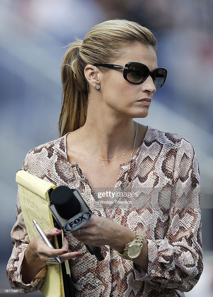 Fox Sports reporter Erin Andrews is seen during the second half of the game between the New England Patriots and the Tampa Bay Buccaneers at Gillette Stadium on September 22, 2013 in Foxboro, Massachusetts.