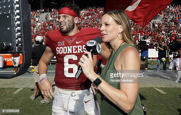 Fox Sports sideline reporter Shannon Spake interviews Baker Mayfield of the Oklahoma Sooners after a 4540 win against the Texas Longhorns at Cotton...