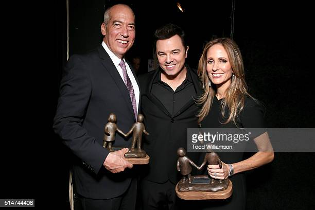 Fox Television Group Chairman/CEO Gary Newman host Seth Macfarlane and Fox Television Group Chairman/CEO Dana Walden pose with the National Champions...