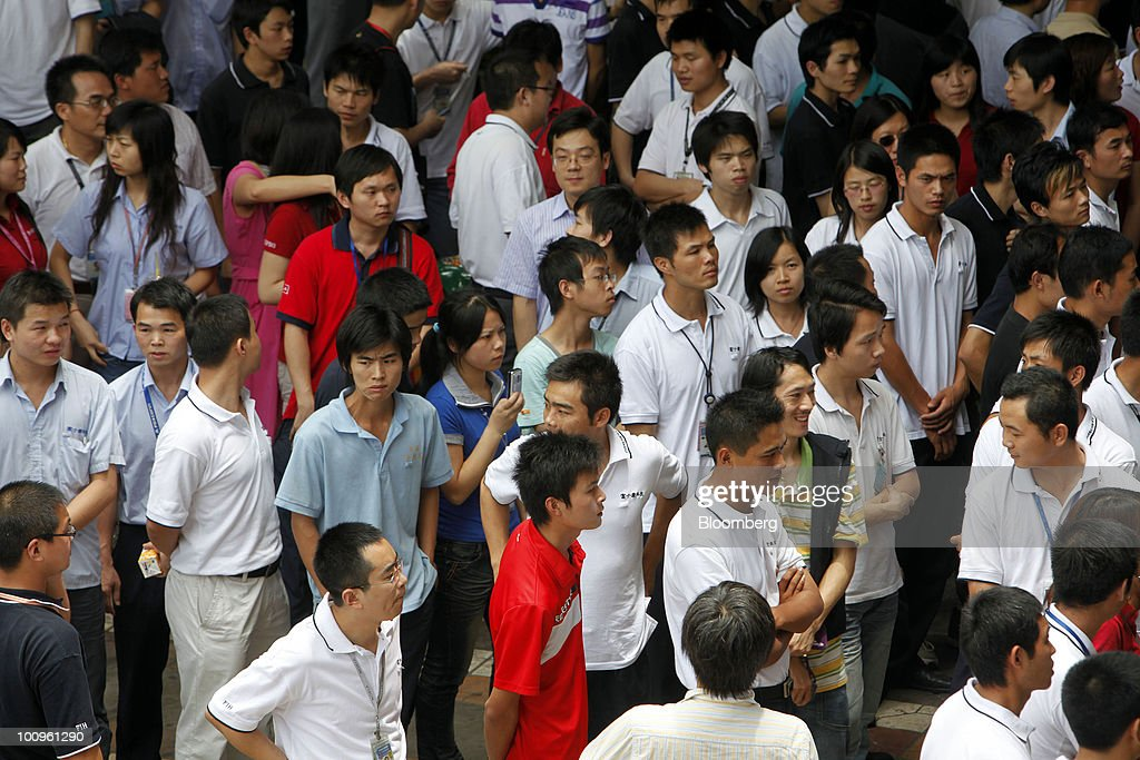 Foxconn employees gather outside the company canteen to get a glimpse of Terry Gou, founder and chairman of Hon Hai Group, not pictured, at Hon Hai Group's Foxconn plant in Shenzhen, Guangdong province, China, on Wednesday, May 26, 2010. Gou said nine of the 11 company workers who either committed suicide or attempted to had worked at the company less than a year, and six had been employed for less than a half-year. Photographer: Qilai Shen/Bloomberg via Getty Images