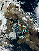 Officially spring, perhaps, but even as late as April 19, 2002, Foxe Basin in northeast Canada, inland of Baffin Island, was still locked in winter. Foxe Basin is at the top of this MODIS image, but s