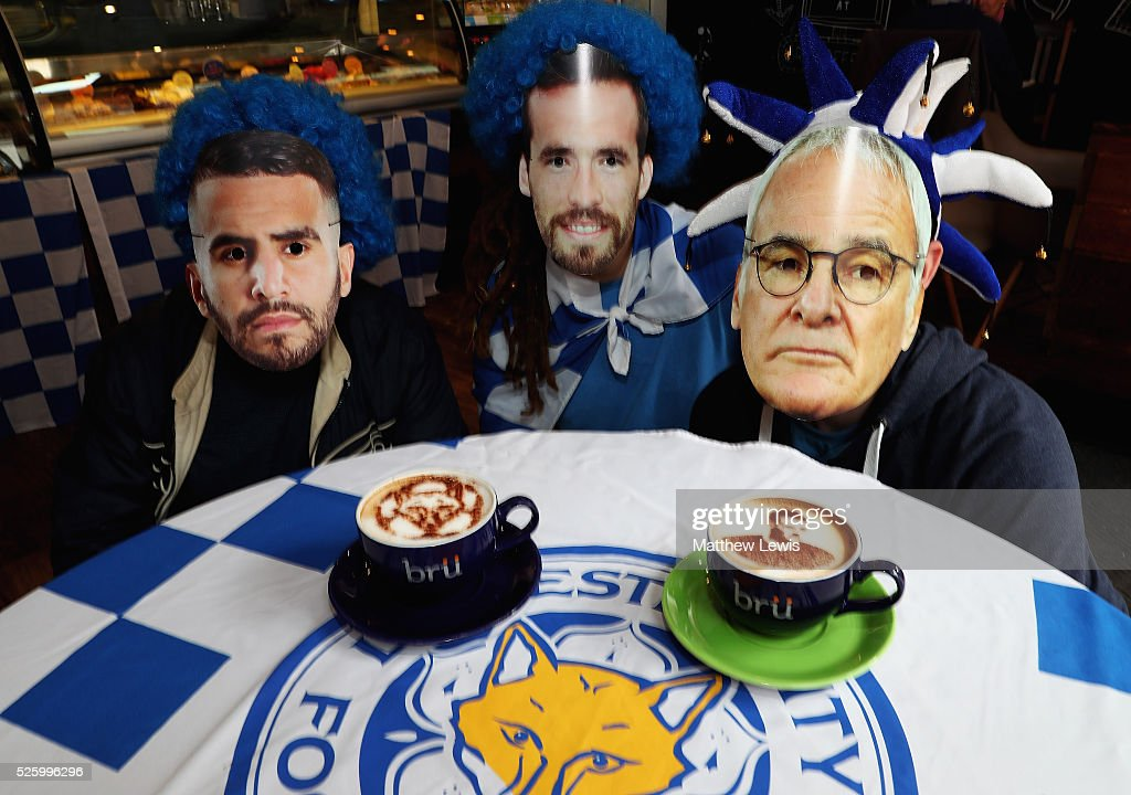A Foxiccino and Vardyccino are pictured with staff from Bru Coffee shop, as they show their support towards Leicester City FC during a Leicester Backing the Blues Campaign in support of Leicester City on April 29, 2016 in Leicester, England.