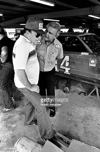 J Foyt left has a serious conversation with his longtime business partner Jim Gilmore in the Daytona International Speedway garage after Foyt damaged...