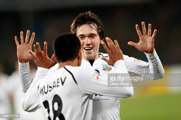 Fozil Musaev of Bunyodkor celebrates scoring his team's first goal with team mate Oleg Zoteev during the AFC Champions League Group match between...