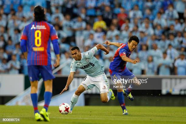 Fozil Musaev of Jubilo Iwata and Kensuke Nagai of FC Tokyo compete for the ball during the JLeague J1 match between Jubilo Iwata and FC Tokyo at...