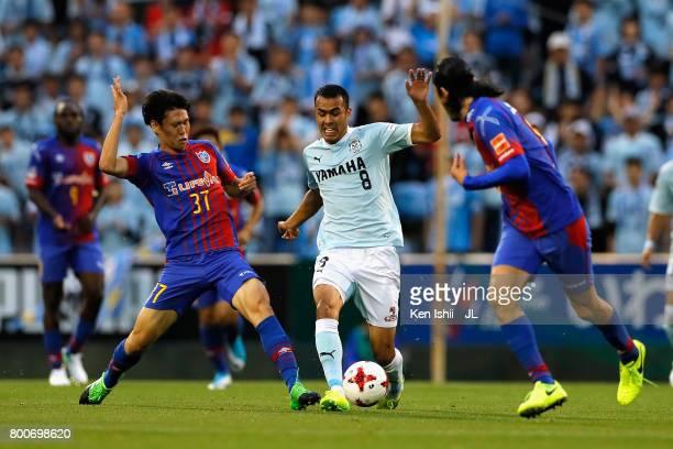 Fozil Musaev of Jubilo Iwata competes for the ball against Kento Hashimoto and Yojiro Takahagi of FC Tokyo during the JLeague J1 match between Jubilo...