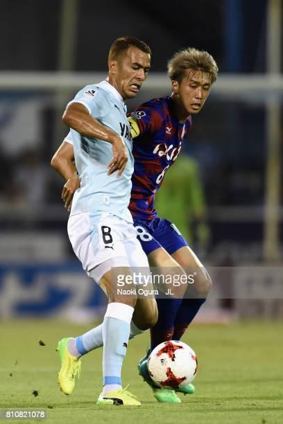 Fozil Musaev of Jubilo Iwata controls the ball under pressure of Ryohei Arai of Ventforet Kofu during the JLeague J1 match between Jubilo Iwata and...