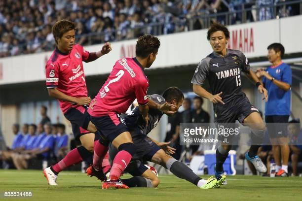 Fozil Musaev of Jubilo Iwata is challenged by Riku Matsuda of Cerezo Osaka during the JLeague J1 match between Jubilo Iwata and Cerezo Osaka at...