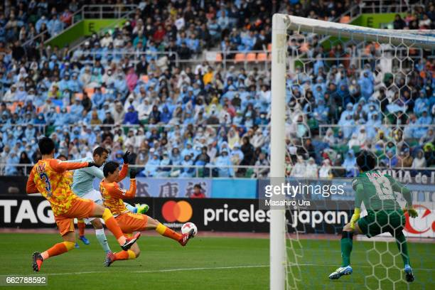 Fozil Musaev of Jubilo Iwata scores his side's second goal past Yuji Rokutan of Shimizu SPulse during the JLeague J1 match between Jubilo Iwata and...